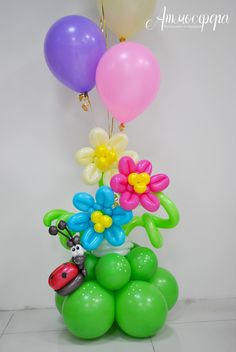 Beautiful spring themed balloon centerpiece. Gotta love the cheeky ladybug.