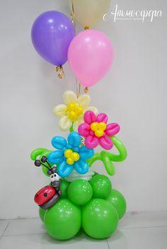 Beautiful spring themed balloon centerpiece. Gotta love the cheeky ladybug.