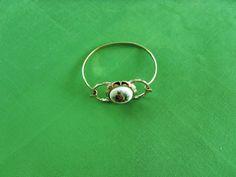 Gold-tone Cuff Bracelet with Yellow Flower by LaylaBaylaJewelry