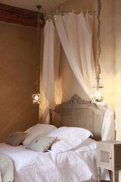 Love the linen linens .  Canopy is so simple.  Love the lights. La Maison des Remparts