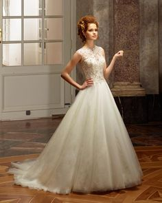Dress: 4114  Available Colors:  in Ivory/Ivory/Silver or WhiteWhite/Silver   Material: Tulle  Available sizes: EU 32-64                          UK 6-38                          USA 2-34