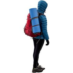 A female hiker dressed for the elements carrying some light camping gear on her back.