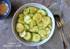 Asian inspired cucumber salad with sesame + rice wine vinegar and all sorts of good things! Perfect for summer