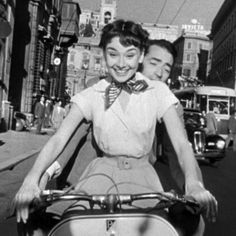 Audrey Hepburn in Roman Holiday tearing it up around Rome on a scooter.