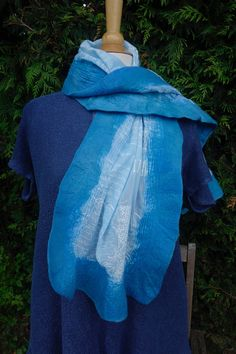 A personal favourite from my Etsy shop https://www.etsy.com/uk/listing/522566906/nuno-felted-scarf-blue-nuno-felted-wrap