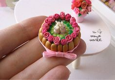 Dollhouse miniature Easter charlotte cake topped with fondant bunnies