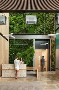 green wall and marble and wood reception in loft entryway