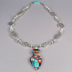 """""""She Comes from Dawn with First Born"""" Necklace Item: HJ5086C Material: Sterling silver, opal, sugilite, chrysoprase, coral with Lone Mountain, Blue Gem, Sea Foam and Bisbee turquoise Size: 22"""" necklace, 3"""" x 1 3/8"""" pendant Period: contemporary Origin: Jemez Pueblo Artist: Phil Loretto Price: $4,800.00"""