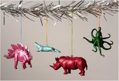 painted dinosaurus! for the kids tree. can you imagine santa with these for reindeer? maybe as an elf on a shelf set uP>
