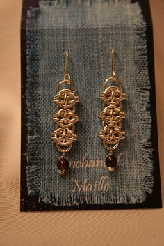 Celtic visions gold chain mail earrings, with garnet drops