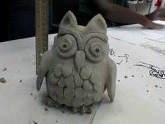 Clay owl. Two pinch pots.