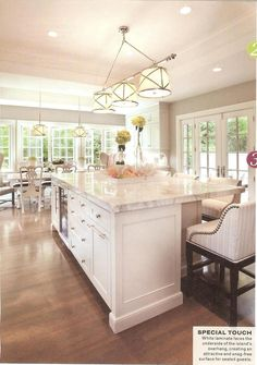 Love the airy, bright but warm feeL of the open plan colours of white, pale grey marble work tops, sodden floor, light walls.