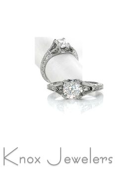 This unique engagement ring is a 1.20 carat cushion cut center stone fashioned in this vintage inspired design. Hand wrought filigree adds a decorative statement to the top and sides of the ring. The scroll pattern is highlighted by the contrast of the carefully stippled background. Accent diamonds adorn the band to add sparkle and brilliance. lick on pin for more info.