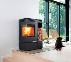 Aduro 12 - The Aduro 12 is a cube style wood-burning stove with large corner glass to provide stylish view of the flames from several angles. This stove is the ideal corner solution, since the flue outlet can be angled to both sides.