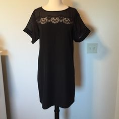 LIKE NEW Jessica Simpson dress Pretty black shift dress with lace and mesh detail at top and on sleeves. Short sleeve with cuff at hem. Lined chiffon front and knit back. Jessica Simpson Dresses