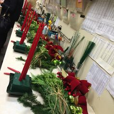 Prepping for our centerpieces! You will need: Cedar Boxwood Pine Silver tip fir One velvet bow 3 pine cones  3 bulbs  Trimming shears