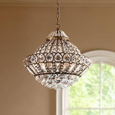 Add antique dazzle to your decor with this glistening brass and crystal chandelier.