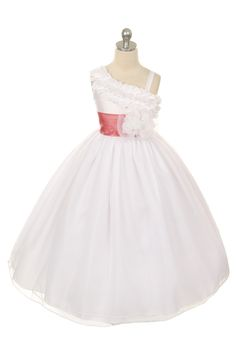 All princesses need that special dress to wear to their next big event. This is that dress! This dress has lots of style and flare. This satin and organza style has the cutest one shoulder, ruffle strap that is unique and trend setting. We love the removable sash and flower on the bodice that add an elegant touch to the look. The style features a zipper back and is fully lined. This dress is made from a designer label that upholds to the highest in quality and super cute style and value. Do…