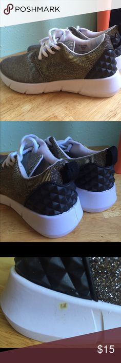 NWT gold sparkle sneakers with detailed heel Super cute. Small defect in outside of right shoe (see photo 3). Very soft and comfortable shoe, my wide toes really just need a 6.5W. Shoes Sneakers