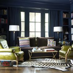 Jan Showers - dens/libraries/offices - bold, peacock, blue, teal, glossy, walls, paint, color, built-ins, bookshelves, chocolate, brown, velvet, sofa, green, leather, chairs, white, black, zebra, cowhide, rug, crystal, floor lamp, blue, drapes, brass, mirrored, coffee table,