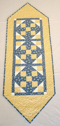 Brighten up your spring / summer table with this cute yellow and blue quilted table runner. Darling cute tiny white flowers, cherries and chicks make this table runner a gorgeous country home decor. It would make a great Easter or spring table decor, gift Table Runner And Placemats, Table Runner Pattern, Quilted Table Runners, Tiny White Flowers, Blue Flowers, Quilted Table Toppers, Small Quilts, Mini Quilts, Sewing Table