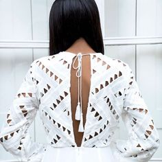 White top with cutouts and tassels