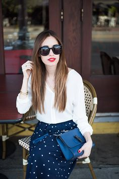 classic and feminine outfit: white blouse with navy polka dot skirt