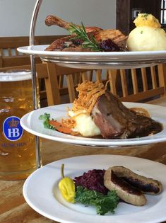 Check out this tower of food for Christmas at Hofbräuhaus Las #Vegas. It's got roast duck, roast pork and veal bratwurst with red cabbage and potato dumpling.