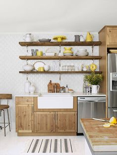Kitchen Designs - Pictures of Kitchen Designs and Decorating Ideas - Country Living - what is a good alternative to the cupboard...color?? Suggestions! Like the gray white and yellow!