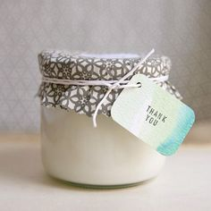 Great recipe from Ruffled for homemade soy candles that cost less than a dollar to make (not including price of chosen container:)