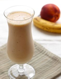 Perfect Breakfast Smoothie -Peach and Banana with Milk and Ice Cubes