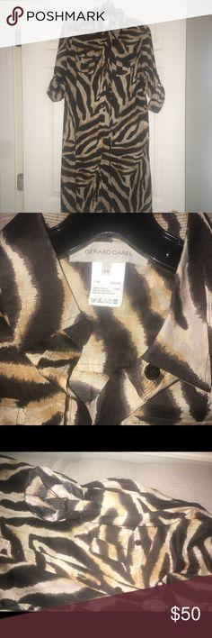 Gerard Daniel size 44 button up dress EUC Fun animal print dress from Neiman Marcus, never worn . Has belt if you want to use it. Rolled/button sleeve. Has side slits, short. Fits like a 6, would be cute swim cover up too, need underneath slip. Gerard Darel Dresses Mini
