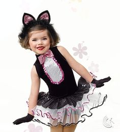 Curtain Call Costumes® - Cat Nip Black stretch velvet boy short leotard with keyhole back, lined poly bodice panel, and mini reflection bow tie trim. Attached net tutu with sequin trim and mini reflection top skirt. INCLUDES: cat ear headband. Troupe price: $65 AUD - $70 AUD