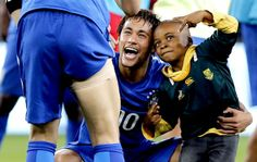 This is amazing! Neymar and Ayo Dosumu, a South African boy who invaded the field and had fun with the Brazilian players after the match held at Soccer City, which Brazil won 5-0 • March 5, 2014.