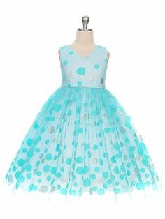 Aqua V-Neck Polka Dot Tulle Overlay Dress Style: Silver glitter contrasting polka dots Sleeveless bodice w/ v-neck & back Silver trim at waist Zipper closure w/ tie back tulle sash Crinoline layer & lining within Chic Baby 351