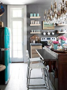 Luxe gray brings glamour to a utilitarian room. A posh color instantly ups the oomph of a kitchen.