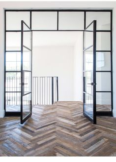 Steel doors and reclaimed wood chevron pattern. Steel doors and reclaimed wood chevron pattern. The post Steel doors and reclaimed wood chevron pattern. appeared first on Glas ideen. Planchers En Chevrons, Interior Architecture, Interior And Exterior, Interior Glass Doors, Glass Office Doors, Steel Frame Doors, Casa Loft, Deco Design, 2017 Design