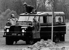 Queen Elizabeth II at the 1972 Windsor Horse Trials. The Duke of Edinburgh looks on as Prince Edward plays on the roof of their Land Rover and Prince Andrew leans against the vehicle