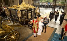Queen Elizabeth II and the Duke of Edinburgh arrive for the State Opening of Parliament at the Palace of Westminster, June 4, 2014