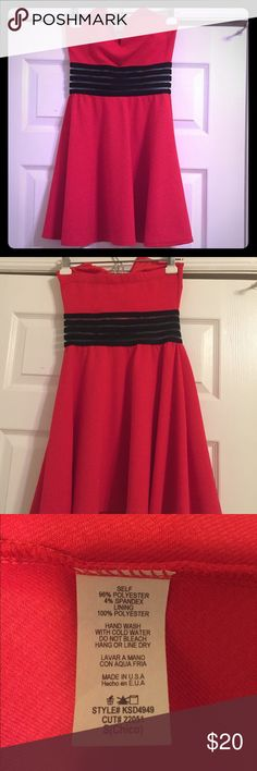 Plunging Front Red Mini Dress NWOT. Never worn. This deep v mini dress has slight see through black material in the center that creates a peek a boo belly. Extremely flattering. Dresses Mini