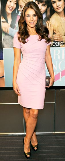 Elizabeth Hurley in a pink bandage dress and gold peeptoe heels
