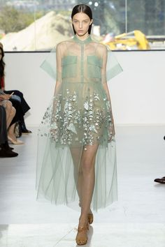 A last inspiration was marine life as captured by Leopold and Rudolf Blashka's 19th Century glass creations—evident on an achingly lovely mint green embellished  shirt dress. It's a show of light and magic, leveraging fantastical ideas with technical prowess.   - HarpersBAZAAR.com