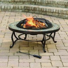 Your outdoors just got warmer with this Natural Slate Fire Pit. This fire pit has a mesh spark lid that disallows the embers of fire to reach onto your guests. Featuring a steel fire pit and natural slate top, this circular fire pit is strong and sturdy. Wood Fire Pit, Steel Fire Pit, Wood Burning Fire Pit, Fire Pit Table, Fire Pits, Foyers, Fire Pit Designs, Fire Bowls, Fire Pit Backyard
