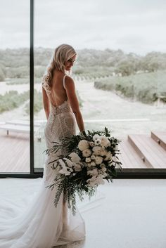This overflowing bridal bouquet of greenery + white florals makes a sweet statement | Image by Shannon Stent Images