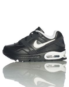 NIKE Medium top sneaker Front lace closure Padded tongue with logo Signature swoosh on sides Air bubble heel for comfort