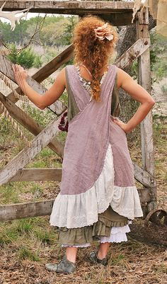 That same cross-back apron dress (which I think would be wonderful in lightweight linen) this time with a wide ruffled lace trim. Kind of prairie -look, but still cute....