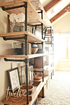 Want to make those awesome industrial pipe shelves? Check out this helpful DIY tutorial on how to install industrial pipe shelves in your home. Industrial Pipe Shelves, Industrial House, Industrial Interiors, Wood Shelves, Industrial Style, Industrial Design, Diy Pipe Shelves, Industrial Decorating, Industrial Furniture
