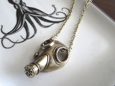 Gas Mask Necklace  by PeculiarCollective on Etsy