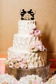 Magnificent buttercream cake from a Disneyland Wedding complete with blushing peonies and roses