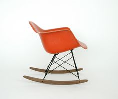 http://www.modernvintage.nl/post/30311791292/eames-herman-miller-rar-red-orange-walnut-chair-for-sale